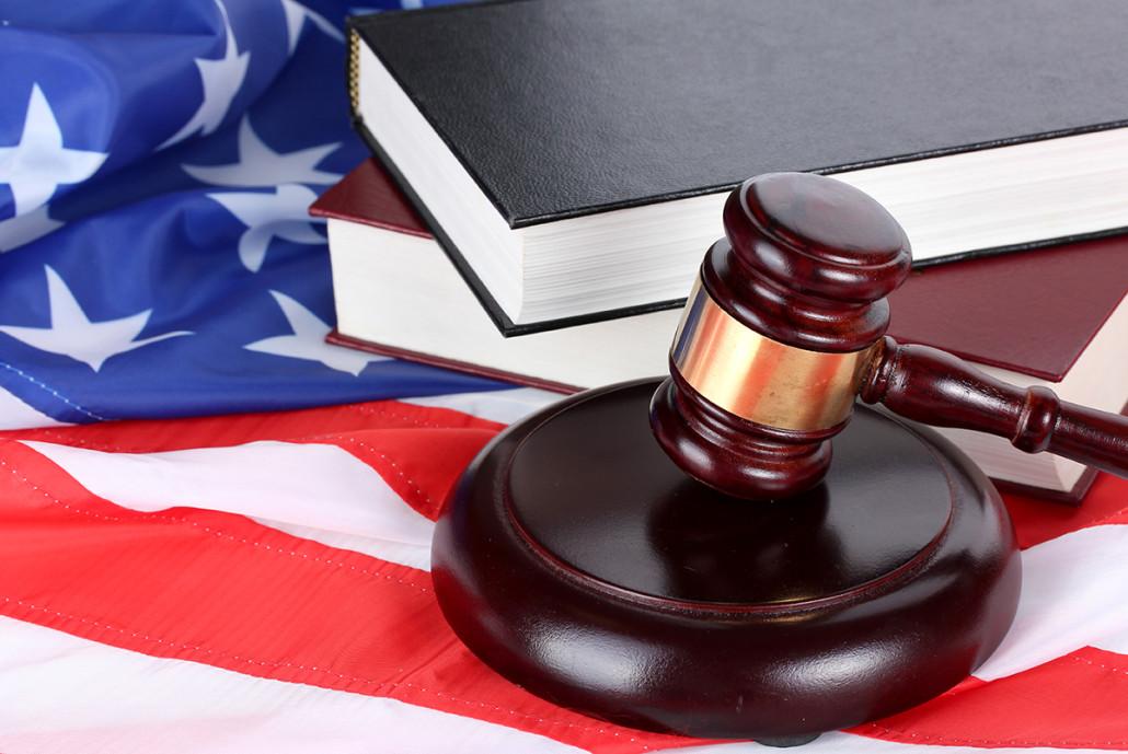 law books and american flag, 10 reasons marijuana is still illegal